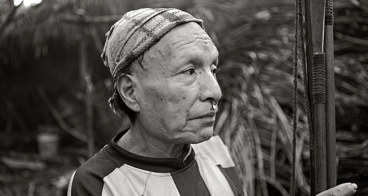 Epa goes back and forth between his tribe and rural communities on the Curanja River in Peru's Amazon region
